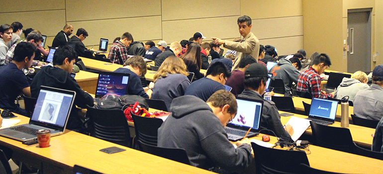 Pictured: Dr. Ray Taheri teaches an engineering class.