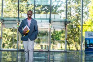 Alum returns to support international students